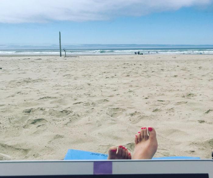 Working and writing at Manzanita Beach Oregon. Heather Sunseri writing thriller novels.